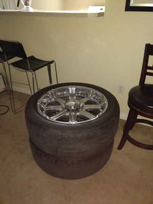 Akuza 22 inch rims and tires dueler h/l avenza. Set of 4 for Sale in Salt Lake City, UT