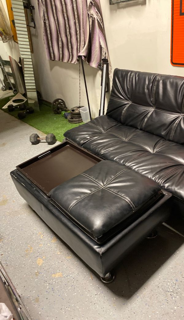 Black leather futon with table autumin great shape 200 . 00