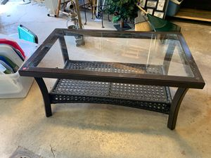 Glass top wood and wicker coffee table for Sale in Bethel Park, PA