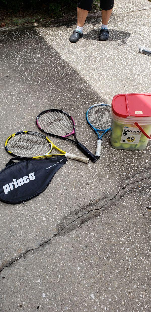 Beginner tennis rackets (3) and bucket of balls