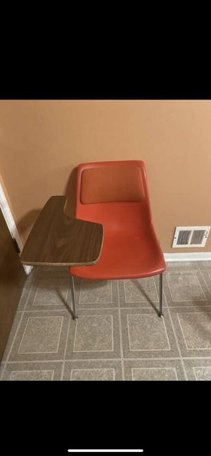 Solid plastic chair with wood desk for Sale in Shelby Charter Township, MI