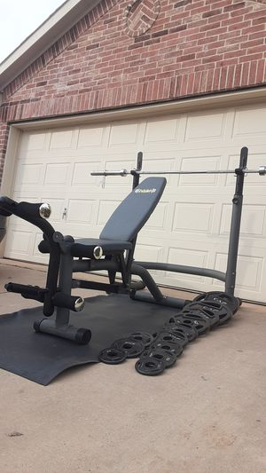 Two piece squat rack bench press with weights and barbell for Sale in Saginaw, TX