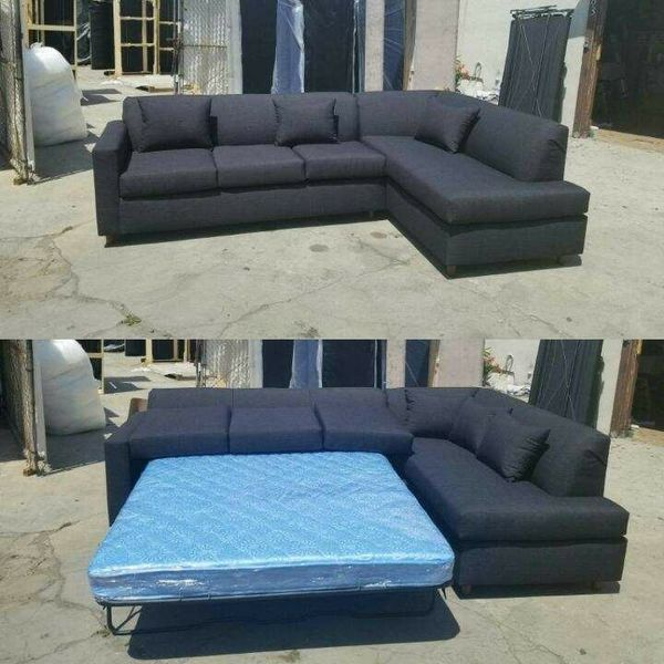 NEW 9X7FT DOMINO BLACK FABRIC SECTIONAL WITH SLEEPER CHAISE