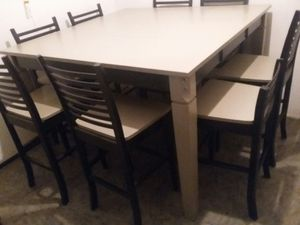 """Bar height table and 8 chairs. All wood and reinforced. With extension 54""""x54"""". without 36""""x54"""". new paint. One chair back shorter for Sale in Montclair, CA"""