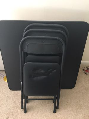 Children's table with 4 folding chairs. for Sale in Silver Spring, MD