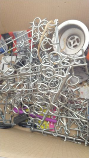 Tons of pegboard hanging clips and tool holders for Sale in Phoenix, AZ