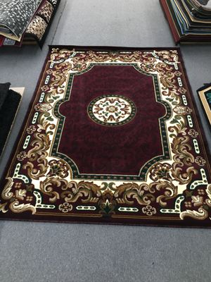 Burgundy color area rug brand new 5x7 foot thick quality for Sale in Salem, OR