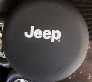 """Jeep Spare Tire Cover - OEM from 2013 Wrangler Sahara - 17"""" wheel cover for Sale in Huntington Beach, CA"""