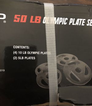 50 lb Olympic Place Set. (4) 10lb plates (5)lb plate for Sale in Riverside, CA