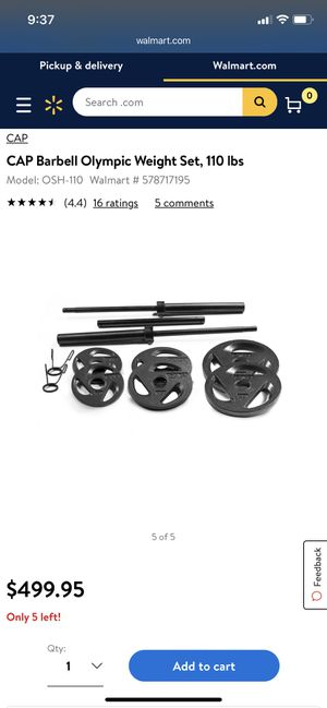 Barbell with plates for Sale in Spanaway, WA