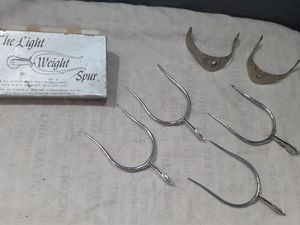 2 pair one new and one use light weight spurs for Sale in Grand Prairie, TX