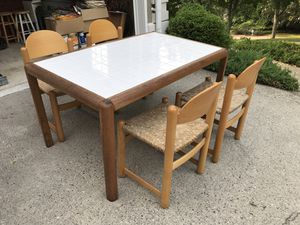 Storehouse white tiled kitchen table and 4 wicker chairs. for Sale in Alpharetta, GA