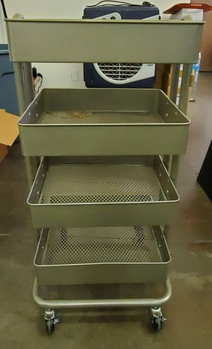 Metal storage cart 4 tier utility rack with wheels silver for Sale in Long Beach, CA