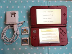 Nintendo 3DS xl red with monster hunter 4 ultimate and animal crossing new leaf for Sale in Charlotte, NC