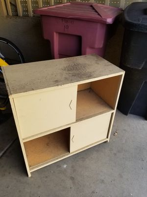 Small wooden cabinet with sliding doors. Beige. Garage. for Sale in Scottsdale, AZ