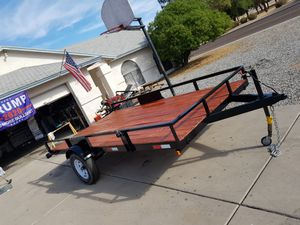 7x13 utility trailer made for sxs with pull out ramps for Sale in Sun City, AZ