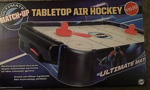 Brand new open box tabletop air hockey table normal price is $20 got as a present and we don't need for Sale in Murrieta, CA