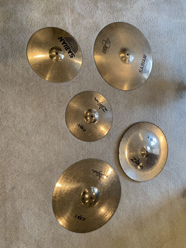 5 cymbals: used zildjian and Sabian. 2 are 20 inch. 1 is 18 inch and 2 are 14 inch.