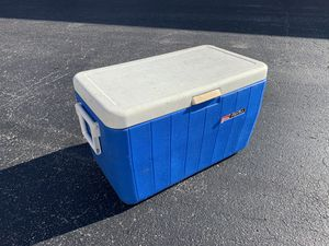 Blue and White Coleman Polylite 34 qt cooler! In good condition. Has crack on side but doesn't affect cooler functionality. Dimensions: 24x14x15in for Sale in West Palm Beach, FL