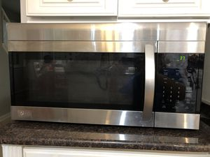 LG 1.7 cu ft over the range microwave oven in stainless steel for Sale in Herndon, VA