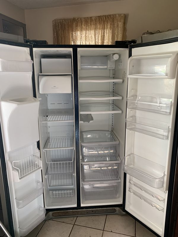 Frigidaire side by side refrigerator with ice maker