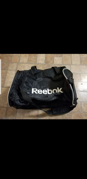 Reebok gym duffle bag black with white print and edge exterior pocket for shoes and spacious for your gym routine or road trip for Sale in Dearborn, MI