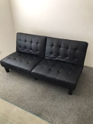Futon multi use couch bed recliner FAUX leather in black six months old two sections in Ontario 91762 for Sale in Chino, CA