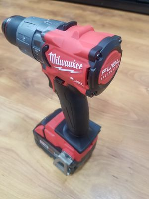 Milwaukee full hammer drill battery 5.0 no charge for Sale in Chicago, IL