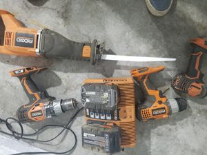 Ridgid Five Piece 18 v Hammer drill impact Sawzall two fully charged batteries and dual charger for Sale in Seattle, WA