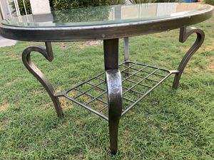 metal coffee table with glass top cute and very good condition. for Sale in Las Vegas, NV