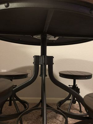 Adjustable wooden table and matching stools for Sale in Bay Lake, FL