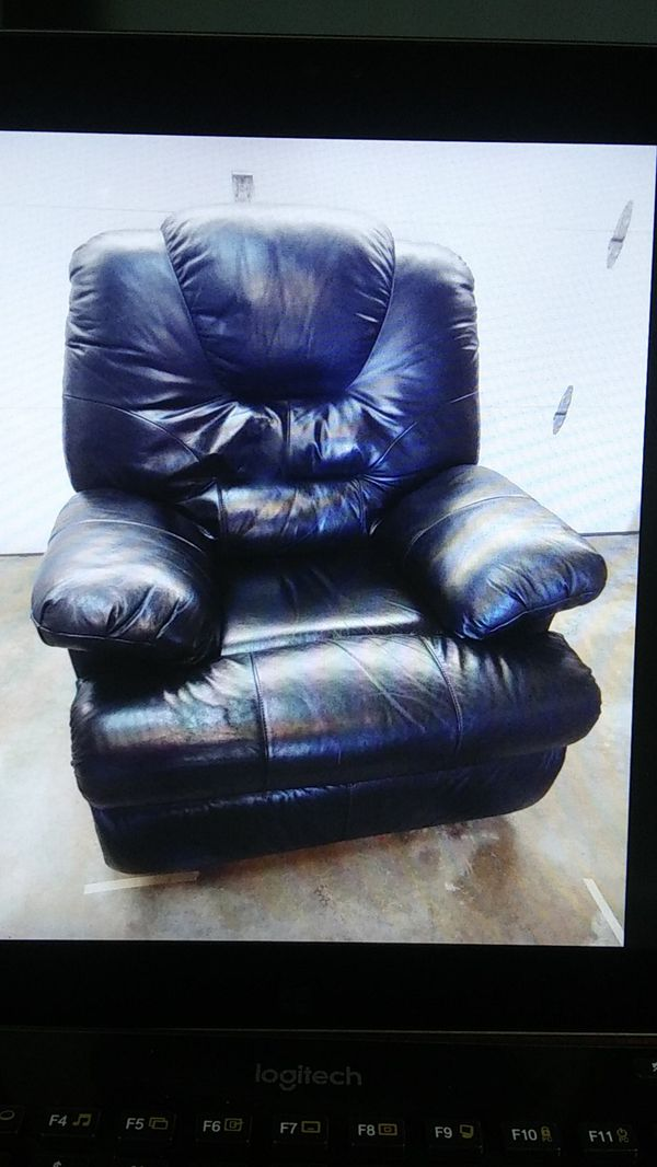 Oversized black reclining chair with footrest