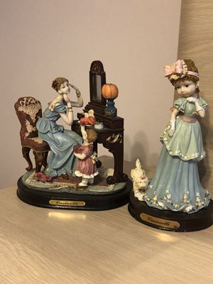 Figurine of vintage woman sitting in front of dresser with small child and the other is a young girl with dog beside her for Sale in Miami, FL