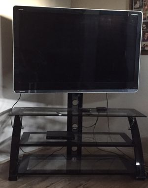 60 inch TV with glass 3 tier TV stand. Moving must sell! for Sale in Industry, CA