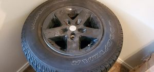 Set of 3 rims and tires for a Jeep Goodyear wranglers for Sale in San Marcos, TX