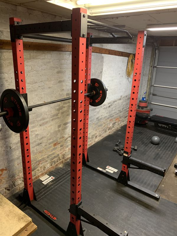 Ethos weightlifting set. Power Rack, Adjustable Bench, 205lb weight set, weight tree, and dumbbells