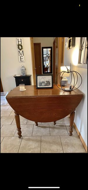 Beautiful antique drop leaf table with 3 chairs. Ivory casters. Perfect for your kitchen, DR, or entryway-so versatile and charming. for Sale in Circleville, OH