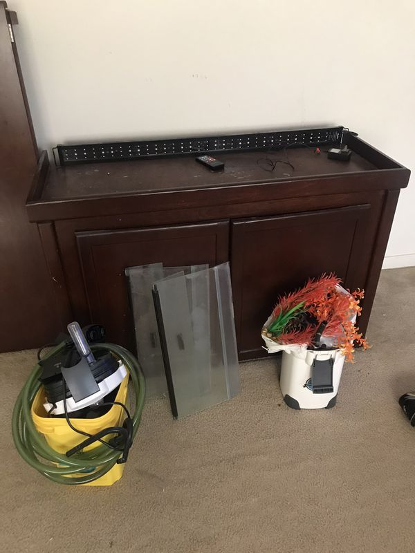 90 gallons fish tank stand, covers , filters, lcd lights with remote control and other supplies