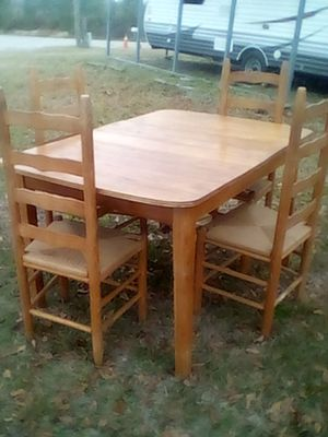 Four piece oak dining table with ladder back wicker chairs. $75 or OBO for Sale in Batesburg-Leesville, SC