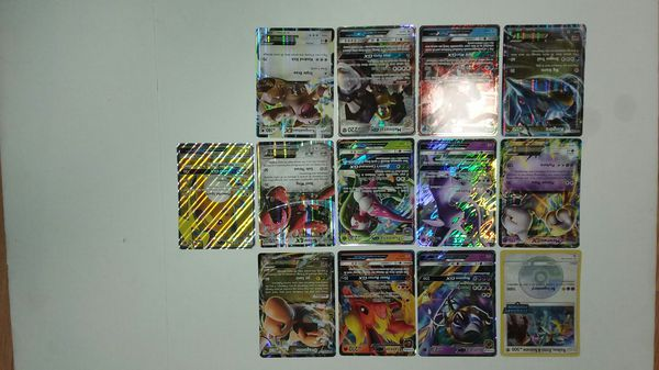 Collection of 13 Jumbo Pokemon cards EX GX etc