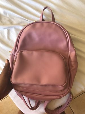 Clean pink with gold parts women's backpack small clean never used just like new leather for Sale in Kissimmee, FL