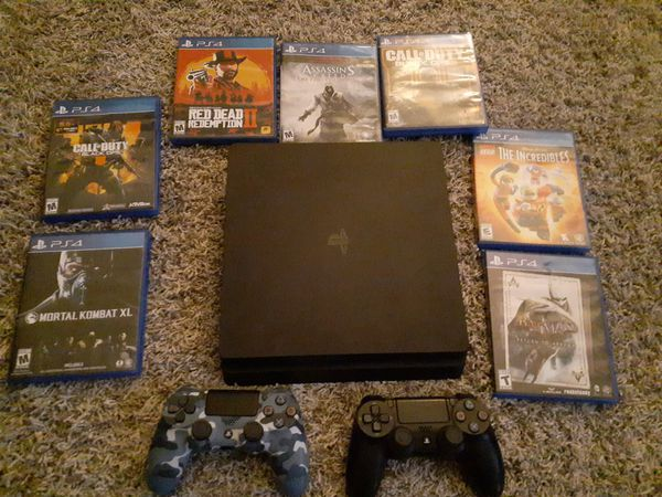 Like new ps4 with 2 controllers & 7 games