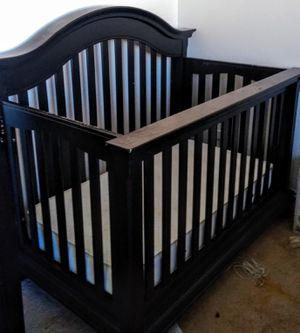Like new black baby crib toddler bed with mattresses for Sale in Murrieta, CA