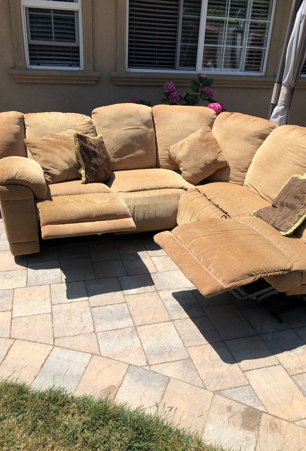 Sectional couch with three recliners.