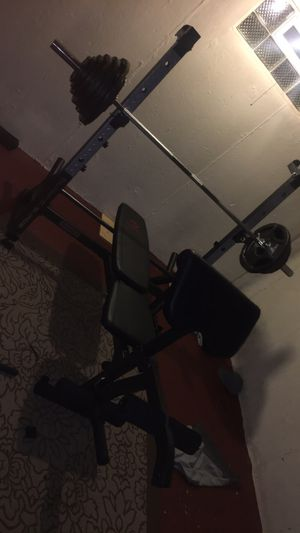 Full Olympic weight set 300lbs with bench for Sale in Cleveland, OH