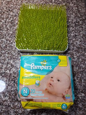 Newborn Dipers Pampers sz N and Bottle drying grass for Sale in North Port, FL