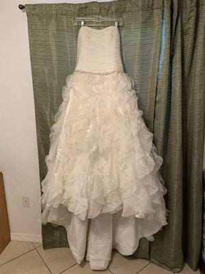 Soft ivory wedding dress. Size 10 - 12 bustle installed on train for Sale in Punta Gorda, FL