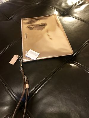 Coach rosé gold wristlet/clutch for Sale in Seattle, WA