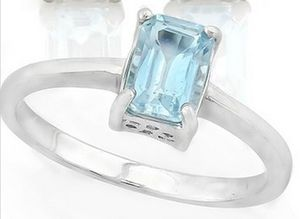 Sky blue topaz emerald cut solitaire ring in sterling silver for Sale in BRUSHY FORK, WV