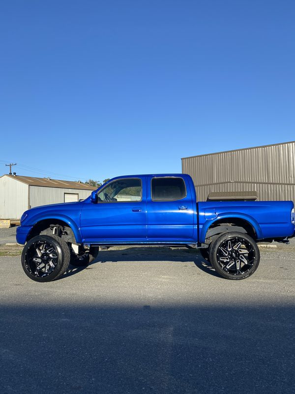 22x12 Gloss Black Rims Wrapped In Nitto 420s